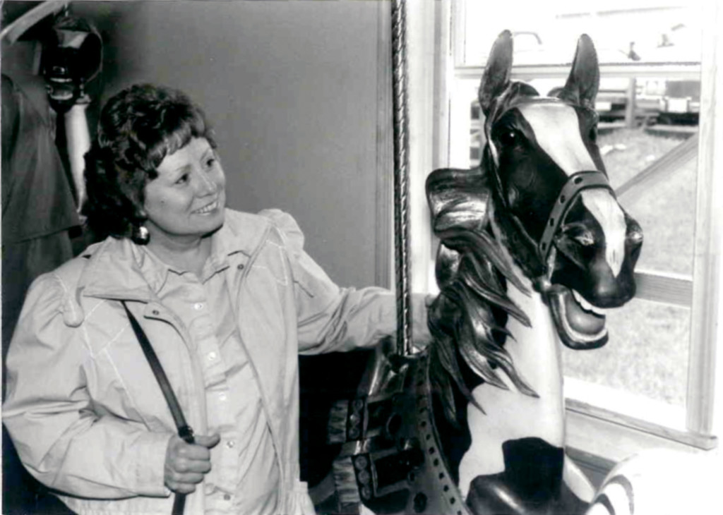 Carousel News & Trader Founding Editor, Nancy Lynn Loucks admires an Illions horse on a visit to Rol and Jo Summit.