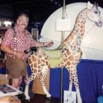 W.P. and his giraffe at the Nevada State Fair, Reno, NV, in the fall of 1992. Painted by Marge Swenson. The figure is now in the private Collection of Lourinda Bray.