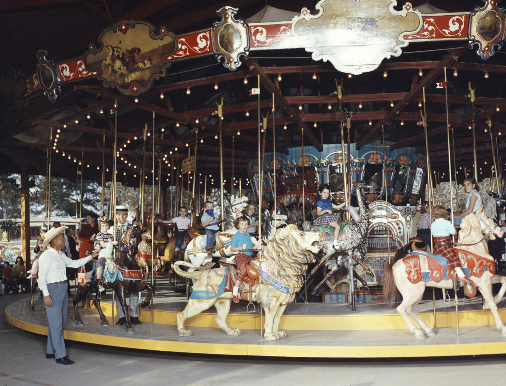 The 1902 Dentzel Merry-Go-Round shown here at Knott's, ca. 1965, was the first ride that Hurlbut brought to Walter Knott. Bud had to convince Walter to let him bring it onto the property. The carousel originally ran at Hershey Park in PA, and then Brady Park in Ohio, before Bud installed it at Knott's Berry Farm in the 1950s.