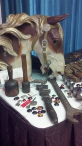 M.  C. Illions carousel horse head and original Illions carving tools.