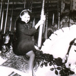 'Rinda at age 6 abord a Zalar/Looff flowered jumper on the Redondo Beach Looff carousel.
