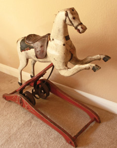 "Circa 1860's Andrew Christian's ""Improved Rocking Horse"" with original paint and remnants of original trappings, obtained from the Nashville Antique Archeology store. The patented improvement was the scroll spring mechanism controlled by a ratchet. This mechanism was intended to replace bow rockers that were used up to this time and were prone to tipping over. William Benjamin collection"