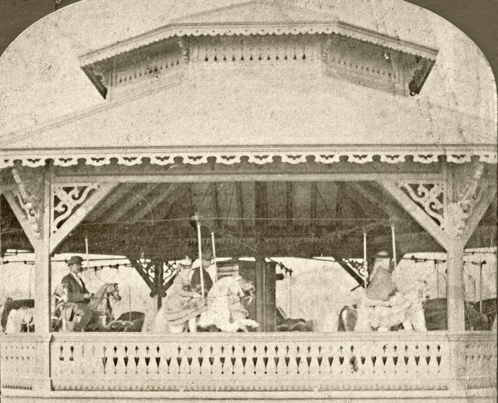 Undated stereoview of the Prospect Park carousel showing Christian-style raised front legs on the horses, center and left. The horse on the right does not have elevated front legs. This carousel, as well as Central Park's, may also have become a hybrid by the date of these photographs, with two styles of horses showing. Barbara Williams collection