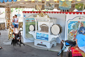 The carousel has a band organ case.  Recorded music is played.