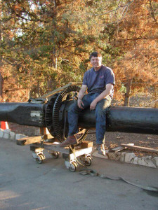 Dan sits on an early 1900s carousel center pole recently unloaded off a truck.