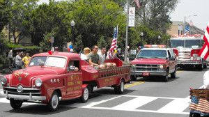 Dan displays his newly acquired Idora Park kiddie fire truck in the South Pasadena 4th of July parade. He tried to be in the parade every year, but would not drive the same truck twice.