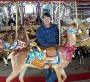 Dan with a Muller deer aboard the restored Astroworld carousel.