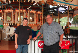 Dan visits a carousel on Route 66. Hiroshi Hanamura photo.
